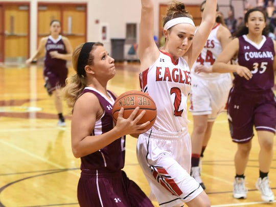 Stuarts Draft's Danielle Brenneman holds up and looks to the basket to shoot as East Rockingham's Meredith Dean during a Region 2A East semifinal game played in Elkton on Thursday, Feb. 23, 2017.  Brenneman scored her 1,000 point during the first quarter of the game.