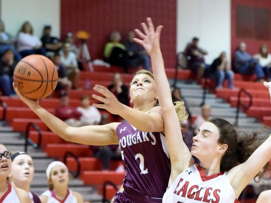 Stuarts Draft's Danielle Brenneman looks to the basket and takes the ball up to shoot and score her 1,000 point alongside East Rockingham's Lexi Dean who guards during a Region 2A East semifinal game played in Elkton on Thursday, Feb. 23, 2017.