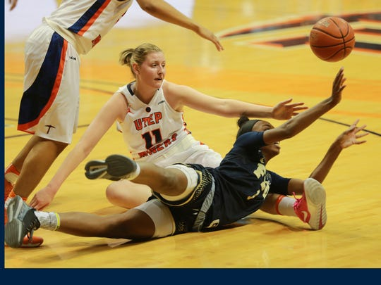 UTEP's Axelle Bernard, and FIU's Kiandre'a Pound scrambled for a loose ball Saturday.