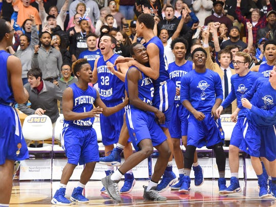 Robert E. Lee players celebrate their win over Dan River High School at the end of a Group 2A state semifinal basketball game played at James Madison University on Friday, March 4, 2017.  Lee plays in the championship game in Richmond on Thursday.