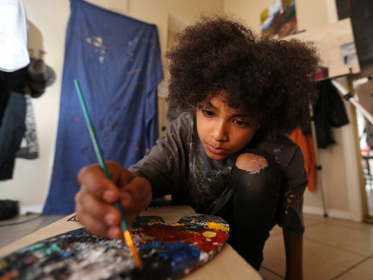Chance Bailey Johnson, 10, worked on a painting Tuesday