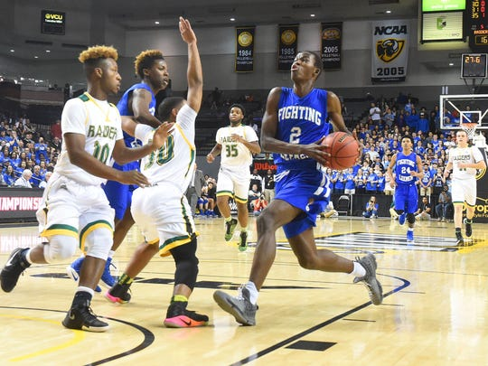 Robert E. Lee's Darius George takes the ball up past Amelia's Larry Jones and Eric Medley as he heads to the basket during the Group 2A state championship game played in Richmond on Thursday, March 9, 2017.