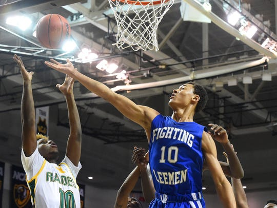 Robert E. Lee's Jarvis Vaughan shoots from under the