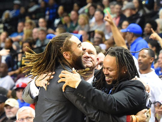 Former Robert E. Lee's head coach Jarrett Hatcher, center, celebrates his team's state championship victory last March with assistants Terrell Mickens, left, and Teley Tate. Mickens is now the interim coach of the team following Hatcher's suspension.