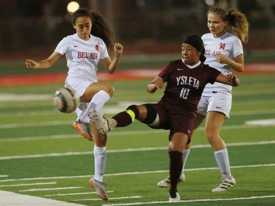 Bel Air's Allison Cohen, left, and Gabriella Mendez battle Ysleta's Jaline Valero for control of the ball Tuesday.