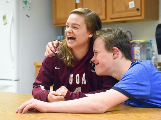Senior Rachel Sauder reacts as sophomore Tyler Hemp, a special needs student at the school, thanks her for asking him to the prom during an interview at Stuarts Draft High School on Thursday, March 16, 2017. Sauder asked Hemp to the school's prom recently — a moment captured on video by a friend.