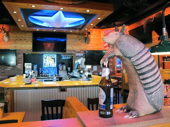 An armadillo grabs a beer at the bar in Texas Roadhouse,