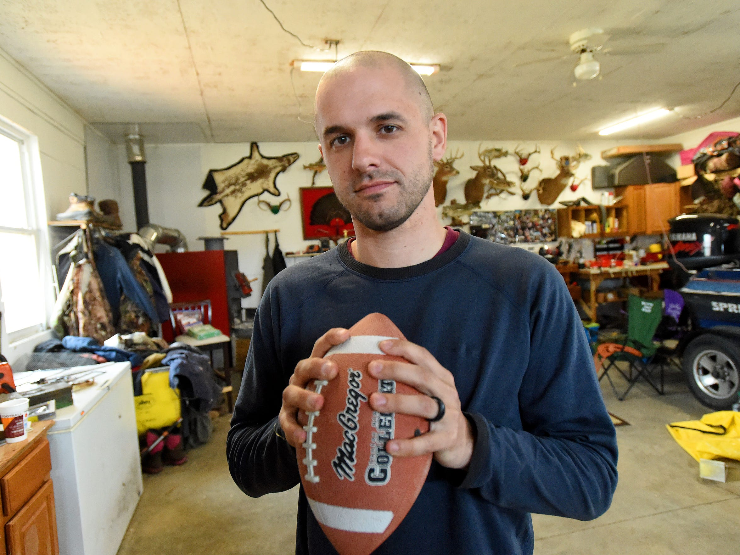 Ryan Rathburn suffered three concussions while playing football at the school. One occurred playing junior varsity football in 2003 with a second during a varsity game in 2005 and a third in practice that same year. He is photographed in Lyndhurst on Monday, March 20, 2017.