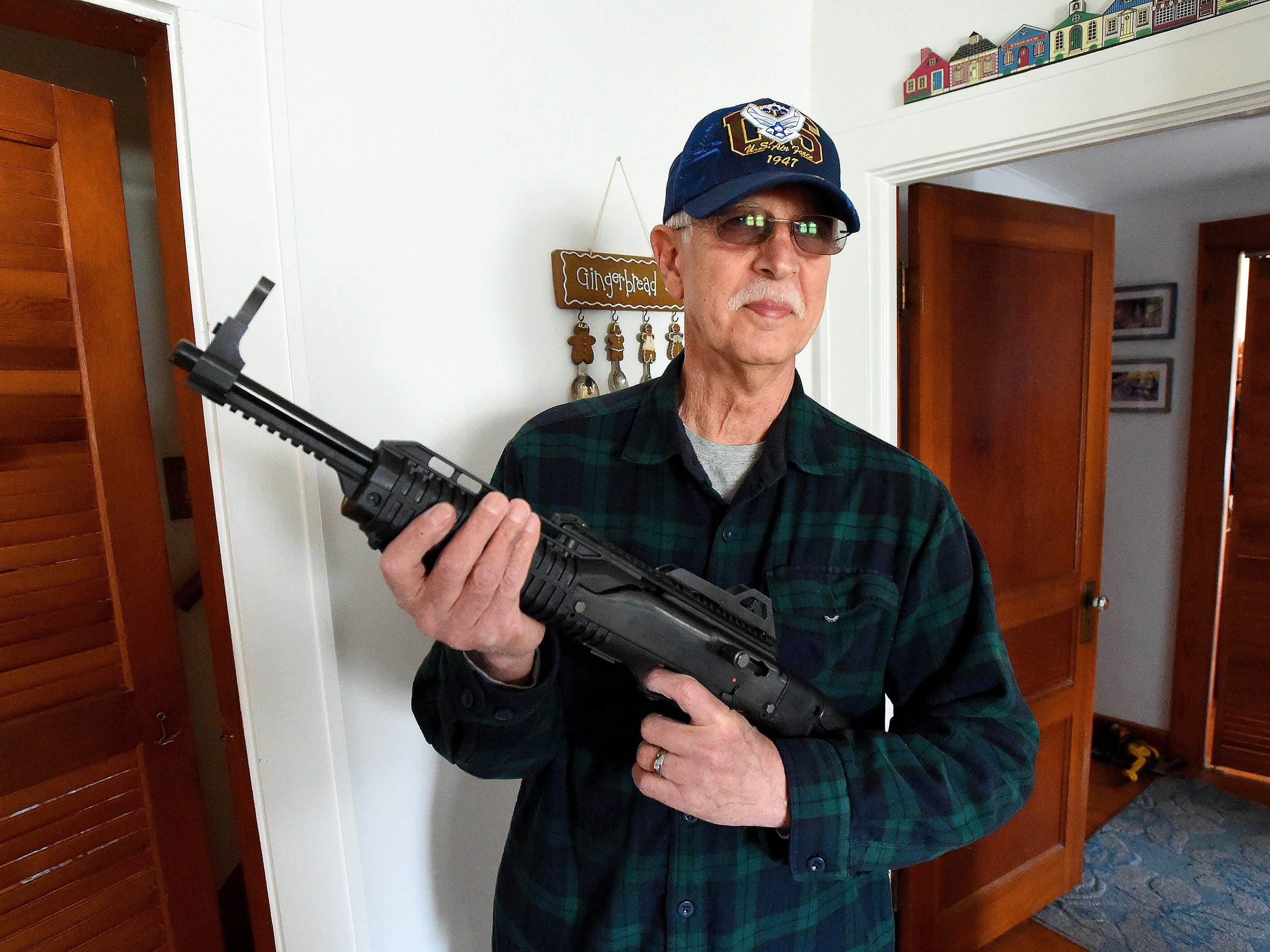 Howard Melnikoff holds his hi point firearms 9mm carbine