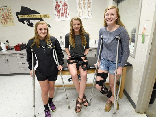 Junior Marybeth Strickler, senior Elizabeth Hanger and junior Hannah Varner of Buffalo Gap High School each sustained ACL injuries while playing basketball. Strickler and Varner's injuries were this year while Hanger's occurred in her sophomore and junior years. They are photographed in the school's athletic training room on Wednesday, April 5, 2017.