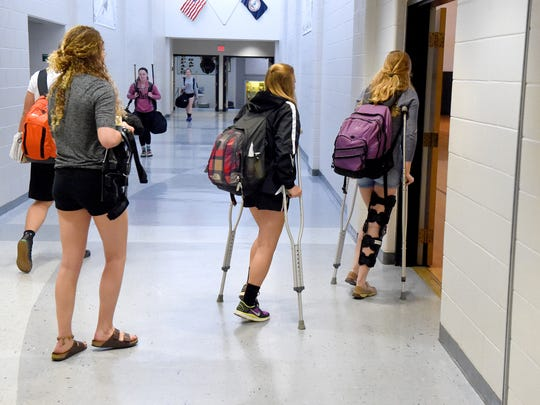 Senior Elizabeth Hanger walks behind juniors Marybeth Strickler and junior Hannah Varner, who use crutches, as they head into the old gymnasium at Buffalo Gap High School on Wednesday, April 5, 2017. All three have sustained ACL injuries while playing basketball. Strickler and VarnerÕs injuries were this year while HangerÕs occurred in her sophomore and junior years.