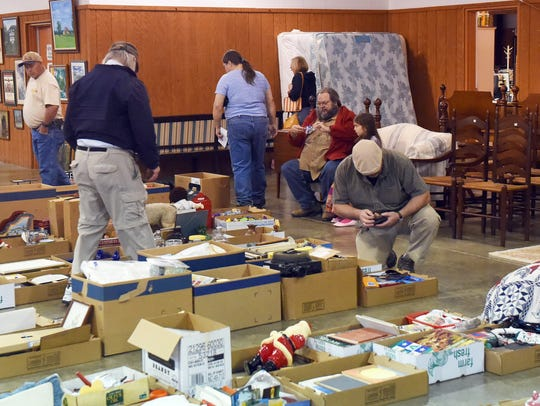Customers browse items destined to be auctioned off