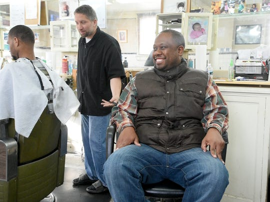 Chris Lassiter enjoys conversation and laughs with friends at D Moats Barber Shop in his hometown of Staunton, Va. Lassiter often uses social media to invite others to join him in face-to-face real-world conversations to help build bridges across race and politics both.