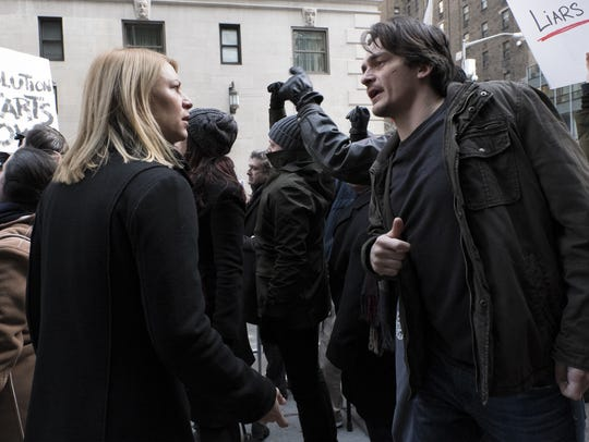 Carrie Mathison (Claire Danes) and Peter Quinn (Rupert