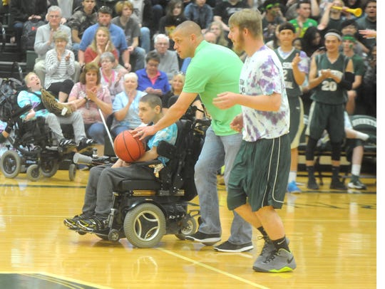 Whitney Coffey hands the basketball to Wilson Memorial's