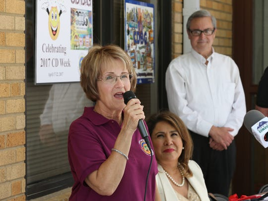 El Paso Community Development Steering Committee Chair Debbie Torres, left, spoke during a ribbon cutting ceremony at the Sara McKnight Transitional Living Center Monday. The center was celebrating  a new roof which was funded through a City Development Block Grant. YWCA CEO Sylvia Acosta is next to Torres and City District 2 Rep. Jim Tolbert is at right.