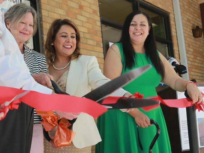 Nancy McKnight Howell, left, YWCA CEO Sylvia Acosta,