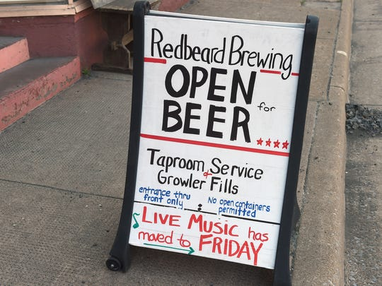 A sandwich board is positioned out front of  Redbeard Brewing Company in downtown Staunton on April 14, 2017.