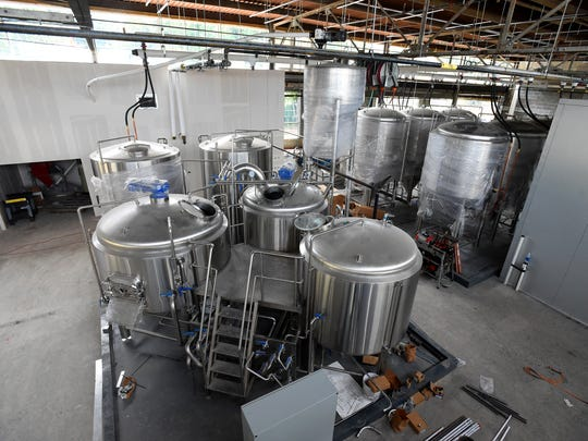 The brewing system and tanks to the left with the fermentation
