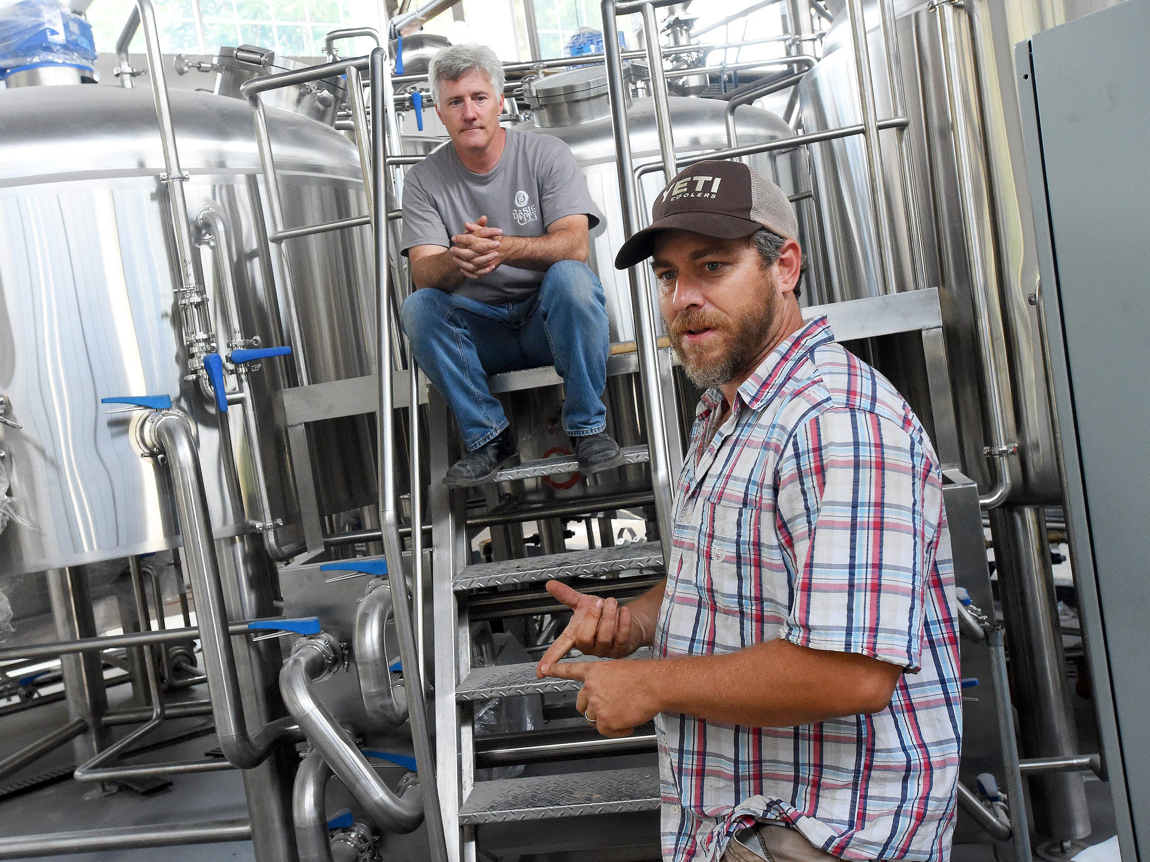 Bart Lanman (right), co-owner of Basic City Beer Co.,