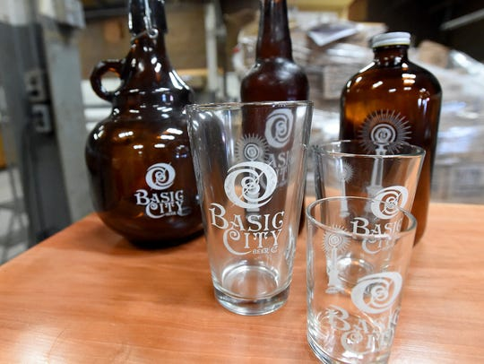 The logo for Basic City Beer Co., printed on glasses