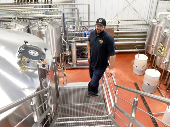 Production brewmaster Joshua French is photographed