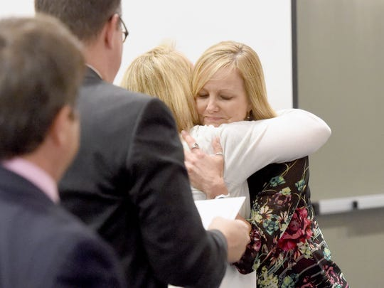 Wendi Shorkey, a physical education teacher at Cassell Elementary, receives a congratulatory hug as she prepares to receive the award after being named Augusta CountyÕs teacher of the year at the Best Western in Waynesboro, Va., on Friday, April 21, 2017.