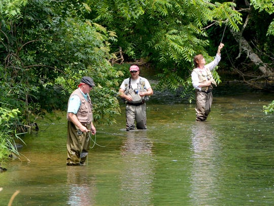 Standing in the South River, instructor Tommy Lawhorne