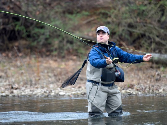 Gui Bravo of Mexico City casts his line upriver. Also a student at University of Virginia, Bravo spent the afternoon taking a break from classes by fly fishing in the South River at Ridgeview Park in Waynesboro in March 2016.