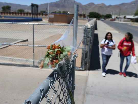 A bouquet of flowers was left on the fence at the Irvin