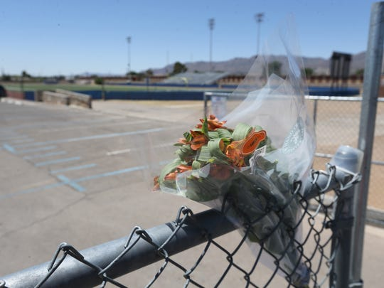A bouquet of flowers was left on the fence at the Irvin High School football/track stadium Monday.