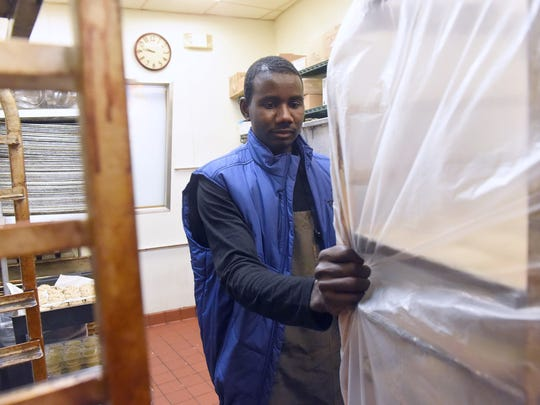 Abdelrahman Abshir moves carts around as he prepares to bake the various breads at the start of his shift. He works as a baker at Panera Bread in Charlottesville, Va., on Wednesday, May 3, 2017. Having lived in Waynesboro since January, he has been on the move since since he was a boy with the conflict in his home of Darfur, Sudan, pushing him out.