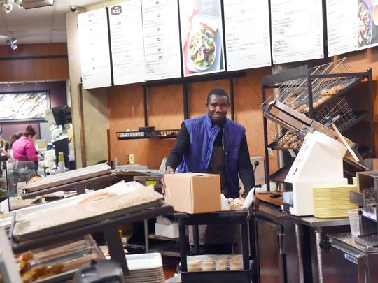 Abdelrahman Abshir pushes a cart behind the counter. He works as a baker at Panera Bread in Charlottesville, Va., on Wednesday, May 3, 2017. Having lived in Waynesboro since January, he has been on the move since since he was a boy with the conflict in his home of Darfur, Sudan, pushing him out.