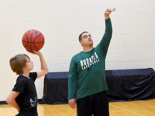 Coach Jeremy Hartman works with young basketball players practicing their skills during an open gym at Wilson Memorial High School on April 27, 2017. It was recently announced that Hartman will be taking over as head coach of the school's boys varsity basketball team.