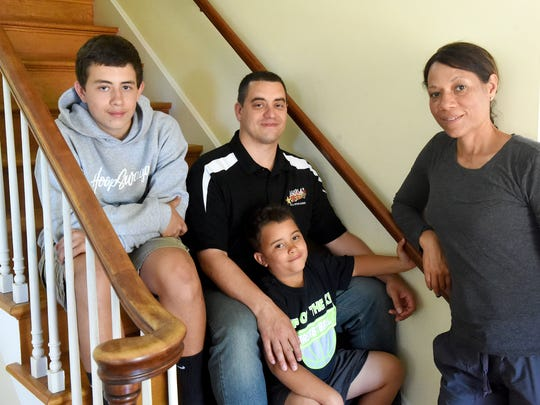 Coach Jeremy Hartman is photographed with his wife, Erin Hartman, as well as their sons, Jaxon Hartman, 13, and son Thad Hartman, 6, in their Staunton home on Wednesday, May 3, 2017. It was recently announced that Hartman will be taking over as head coach of the school's boys varsity basketball team.