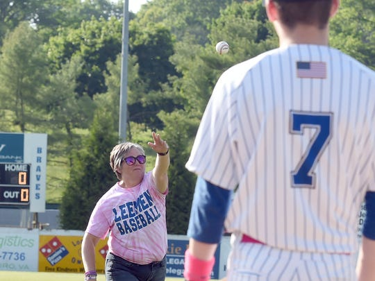 Tracy Morris is one of three cancer survivors to throw out the first pitch at the start of Robert E. Lee's home game against Harrisonburg High School, played in Staunton on Wednesday, May 10, 2017. Morris is the mother of player Noah Morris.