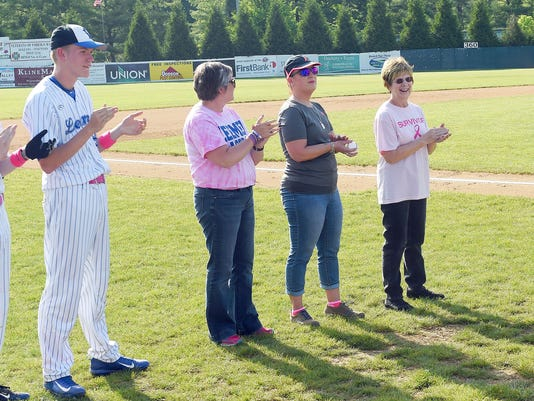 Cancer survivors throw out first pitch