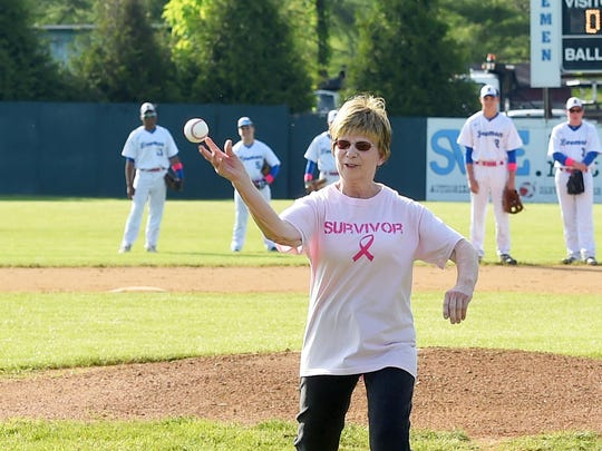 Bonnie Goff is one of three cancer survivors to throw out the first pitch at the start of Robert E. Lee's home game against Harrisonburg High School, played in Staunton on Wednesday, May 10, 2017. Goff is a former volunteer who use to work in the concession.