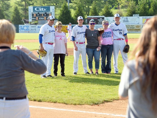Cancer survivor Bonnie Goff stands with Robert E. Lee's head coach George Laase, survivor Lara Steelman stands with son Adam Layer and survivor Tracy Morris stands with son Noah Morris. The three ladies just finished throwing the first pitch before the start of Robert E. Lee's home game against Harrisonburg High School, played in Staunton on Wednesday, May 10, 2017.