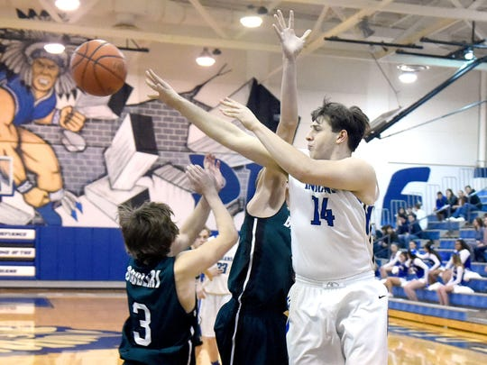 Fort Defiance's Gabriel Glover passes the ball during a Conference 29 quarterfinal game played in Fort Defiance in February 2017.