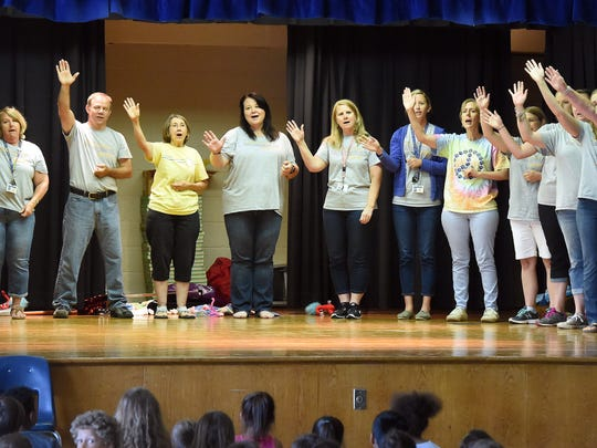 """The teachers perform a parody of """"So Long, Farewell"""" from """"The Sound of Music"""" as their goodbye song to their students on the day before the school's final closing. They participate in Beverley Manor Elementary's 27th annual variety show on Monday, May 22, 2017."""