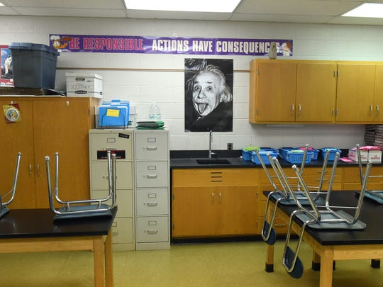 A poster of Albert Einstein hangs on a wall within a classroom at S. Gordon Stewart Middle School in Fort Defiance.