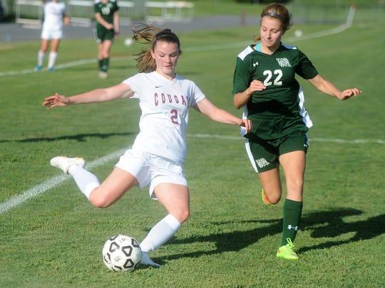 Stuarts Draft's Makenzie Gray tries to score past Wilson Memorial's Chloe Surratt Friday during the Conference 36 girls soccer championship. Draft won 5-1.