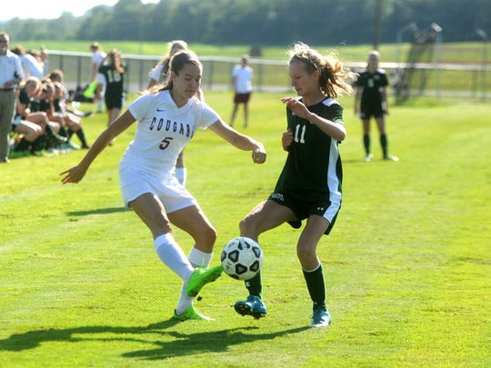 Stuarts Draft's Abby Barlow, left, battles for the ball with Wilson Memorial's Spencer Tuttle Friday afternoon during the Conference 36 girls soccer championship. Draft won 5-1.