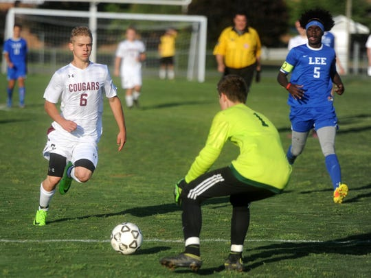 Stuarts Draft's Eric Custard tries to score past Lee High goalkeeper Cullen Wallace Friday. Draft won 3-2 to claim the Conference 36 championship.