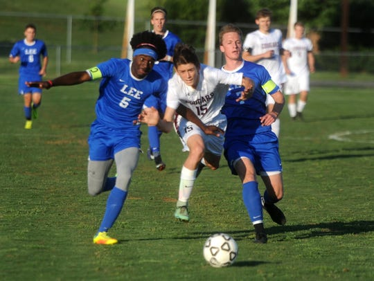 Stuarts Draft's Jacob Pacheco (15) tries to get between