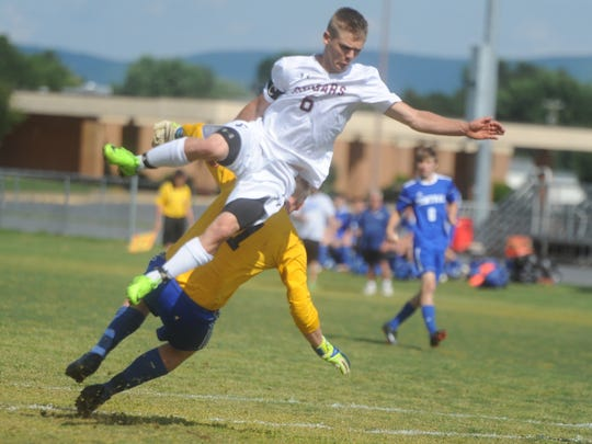 Stuarts Draft's Eric Custard jumps in the air as he goes for the ball during Tuesday's 2A East boys soccer quarterfinal game at Stuarts Draft High School.