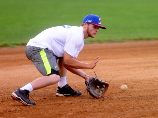 Richard Miller takes some grounders at third Tuesday night at Staunton's Moxie Memorial Stadium. Miller, a junior at Towson University, is playing his first season for the Staunton Braves.