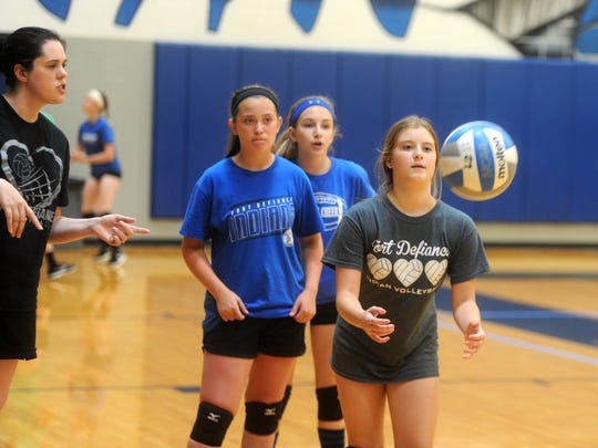 Brooke Truslow, 12, waits for the ball during a volleyball drill at Fort Defiance's volleyball camp Tuesday morning. Abigail Campbell and Olivia Hebb stand behind Truslow waiting their turn, while Fort jayvee coach Julie Roadcap gives instructions.