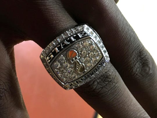 Darius George shows off his state championship ring